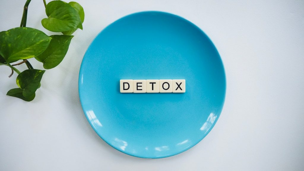 detox text on round plate on table